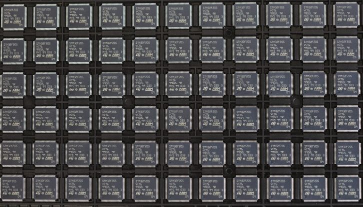 STMicroelectronics IC microchips designed by ARM Ltd. in a storage tray at CSI Electronic Manufacturing Services Ltd. in April. (Chris Ratcliffe/Bloomberg via Getty Images)